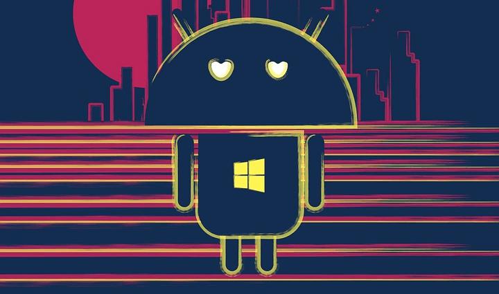На фото изображен андроид и логотип windows.
